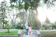 Engagement Portrait Holding Hands Guy Looking at Girl Girl Looking at Camera | Chico-California-Engagement-Wedding-Photographer-Butte-Creek-Country-Club