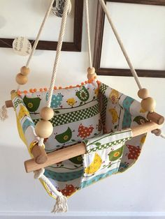 handmade canvas baby swing with by bluebirdbabyhandmade on Etsy, $170.00. We could totally make this ourselves