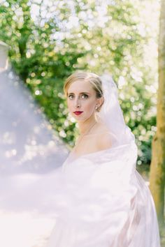 Gorgeous outdoor portrait of a bride with her veil blowing in the wind   www.catherineannphotography.com