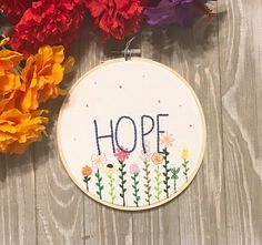 Hope springs eternal.Keep this lovely hoop as a reminder to always stay hopeful.  $20 on Etsy.