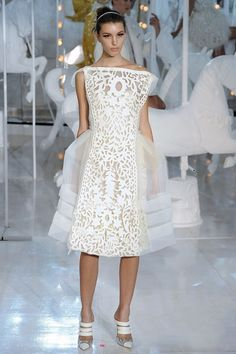 This gorgeous laser cut and tulle style white dress is simply amazing!