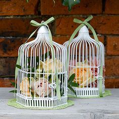 I love these birdcage wedding displays , table peieces they go great with pastels, you can put flowers inside or coloured paper. They are so different to just having a vase as centerpiece