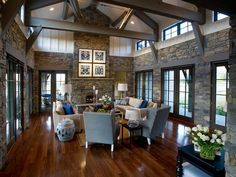 Love the rock walls! Believe this is converted barn.