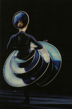 """Berlin, 1977. Dancer and choreographer Gerhard Bohner takes on the challenge of reconstructing the Triadic Ballet by Oskar Schlemmer. He made detailed preparations, studied the source material intensively, and researched the work's history… Bohner's efforts result in a world-wide success. Over thirty years after that, his version of the Triadic Ballet was seen again… Gert Weigelt's photograph of the legendary reconstruction with which Gerhard Bohner gave a fresh look to Schlemmer's work."""