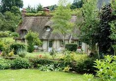 Timber framed thatched Normandy Cottage