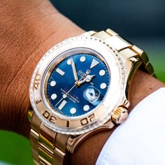 From brunch to the boardroom, the #Rolex Yacht Master Men's Watch - Ref 16628 is the perfect choice. This 18K #yellowgold watch features a stand-out blue dial with luminous style hour markers for a sophisticated yet, modern look.