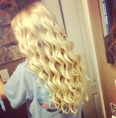Beautiful long curls! Recreate this look with a tapered wand!