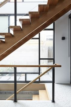 Langford Street's strong form is brought to life by thick Victorian Ash treads. Heavy treads are offset with an open rise, and glass balustrade, filtering light in from adjoining floor to ceiling windows. Brisbane, Melbourne, Timber Handrail, Timber Staircase, Concrete Interiors, Glass Balustrade, Polished Concrete, Floor To Ceiling Windows, Gold Coast