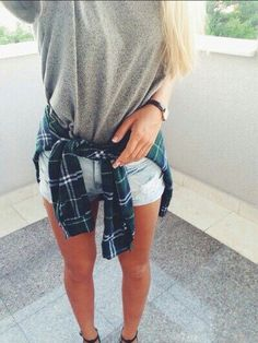 flannel around the waist, t-shirt, jean shorts. casual and adorable