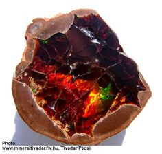 Opal  <<< My daughter's birthstone.  Look at the fire in that stone.  Much like my daughter...  <3~R~<3