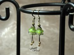 olive and frosty grey double bells with gold glass pearls and a brass filigree bead top 12.00
