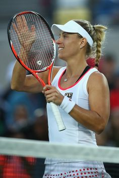 Angelique Kerber of Germany celebrates victory over Johanna Konta of Great Britain in the women's singles quarterfinal match on Day 6 of the 2016 Rio Olympics at the Olympic Tennis Centre on August 11, 2016 in Rio de Janeiro, Brazil. (Source: Clive Brunskill/Getty Images South America)