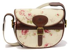 Marlborough World Satchel shoulder Bag.  Marlborough Worlds Rose Pattern Satchel Shoulder Bag is a timeless design made by skilled craftspeople, finished in  brown papaya leather giving you that long lasting use.    The inside of the Satchel is lined in real suede allowing you to have that soft surface for keeping your belongings safe for that extra touch of luxury.