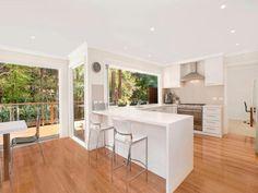 Sleek White Island And Nice Chairs For Modern Open Kitchen Design Inspiration Using Oak Floor