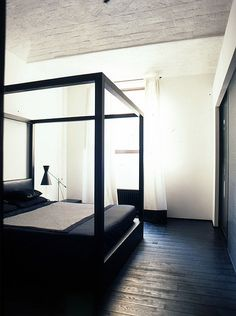 to diy: a home made bed frame in this style. but possibly made out of black metal plumbing pipe?