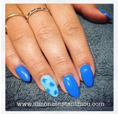 True Blue Baby I love you!  How great is this manicure with gel polish and a touch of nail art?!  Call 02920461191 to book or enquire. Monika's full list of services can be found here: http://ift.tt/2pfS3w6 O.Constantinou & Sons. 99 Crwys Rd Cardiff. CF24 4NF #simonconstantinou #nailsaloncardiff #beautysaloncardiff #nailart #gelnails  #bluenails @opinailsuk @opi_professionals