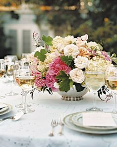 Centerpieces starring garden roses tucked among fat, frilly hydrangeas, sweetpeas, dahlias, and pink jasmine buds