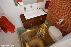 Bathroom built with glass floor above abandoned elevator shaft