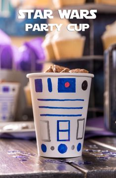 Here's a fun craft idea for your Star Wars Digital Movie Collection viewing party: DIY R2D2 party cups. All you need are white cups and colored sharpies!