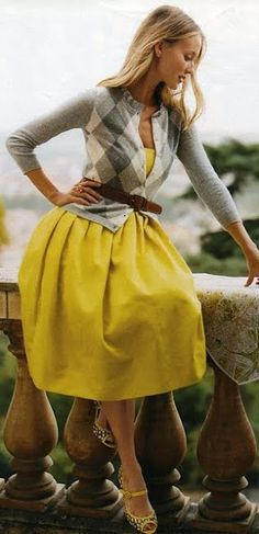 Yellow dress with gray argyle cardigan.