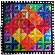 Diamond Rainbow by Lisa S.  Quilted in concentric circles.