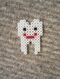 To make: Perler bead tooth magnet!