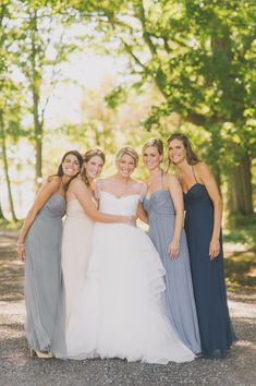 Coordinating grays: http://www.stylemepretty.com//2015/07/27/mix-n-match-bridesmaids-dresses-youll-love/