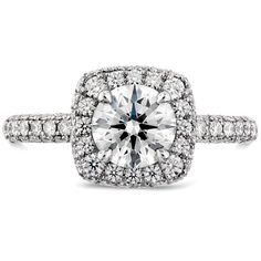 Mountz Jewelers :: This stunning engagement ring is truly euphoric as the double halo sets a dazzling stage for the center stone. Three sparkling rows of diamonds add even more sparkle to this show-stopper, making it the ideal ring for a woman who loves to stand out.