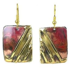 Handcrafted by South African artisans, these rectangular earrings are accented with a copper plate, the color of which is achieved by applying high heat, and polished brass strips. These earrings hang 1.25 inches from brass hooks.