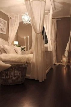 . White Christmas lights, drapes for drama on four corners of the bed.  Again muted tones create a peaceful environment.