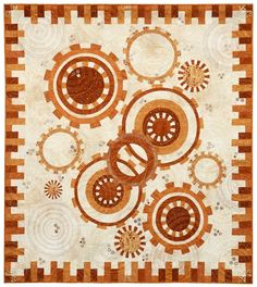 Clever border for gears quilt looks like cogs. Founders Choice Award: Gears by Linda Reinert. 2013 Northwest Quilting Expo.