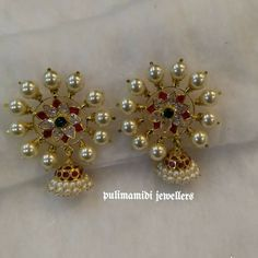 Earrings Studs Stunning gold earrings with jumkhi hangigns. Earrings studded with precious stones. Earrings surrounded by pearls. 26 May 2018 India Jewelry, Gemstone Jewelry, Diamond Jewelry, Gold Jewelry, Jewelry Rings, Jewelry Quotes, Jewelry Stand, Resin Jewelry, Etsy Jewelry