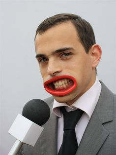Plastic prosthesis designed to distort the wearer's mouth into a tooth-baring grimace.