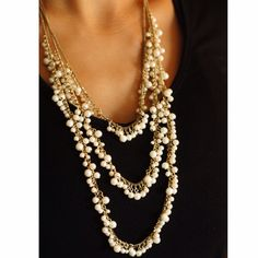 Triple Layered Pearl Necklace BCBG Faux white pearl flows in triple layer necklace. Gold chain with clasp. Perfect condition. No wear or tear. Sorry, no trades. BCBGMaxAzria Jewelry Necklaces