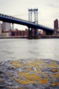"""The DUMBO view of the Manhattan Bridge from a distance in New York City. Original Signed Photography Print Title: """"Manhattan Bridge from a Distance"""" Photographer: Lissette Padilla Location: DUMBO in… Blur Image Background, Blur Background Photography, Desktop Background Pictures, Blue Background Images, Studio Background Images, Picsart Background, Landscape Background, New Backgrounds, City Background"""