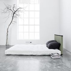 Bedrooms don't get much more minimal than this. Love the concrete floors.