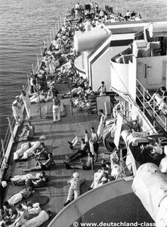 Admiral Graf Spee participated in five international operations patrolling in Spanish waters from 1936 to 1938 because of the Spanish Civil War. On these photos the crew rest on the forecastle and around the forward 28 cm SK L/52 C28 main turret.