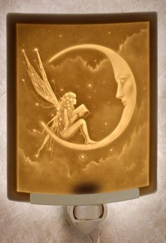 Porcelain Lithophane nightlights ~ made in CA. Many beautiful designs available ~ each one comes boxed with a description of the ancient process used to make them.
