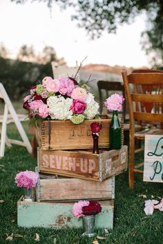 Cottage chic, rustic wedding decor with old drawers or crates, bottles, flower vases
