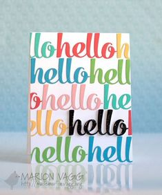 Die cut word repetition in color with focal word in black embellished with glossy accents
