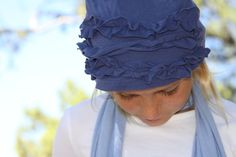 Tutorial of ruffle hat looks easy enough.  Great idea to recycle an old loved t-shirt that doesn't fit kids anymore...maybe even with a cute pic on it.