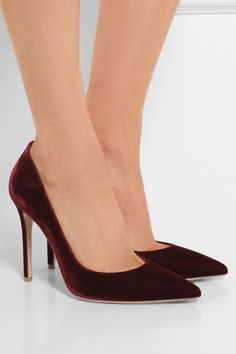 Italian label Gianvito Rossi is world-renowned for timelessly elegant designs. These pumps are an exquisite example, expertly crafted and hand-finished from plush velvet in a rich burgundy hue. The pin-thin heel and pointed silhouette have a flattering leg-lengthening effect.