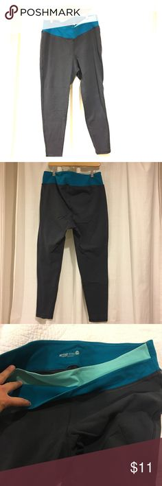 • Old Navy • Yoga Pants / Leggings These steel blue-gray yoga-pant leggings are super comfortable, and great for layering underneath tunics, t-shirts and cardigans! The colorful tulip-style waistband is forgiving and flexible. Pair these pants with knee-high boots, flips flops, or sneakers for versatility! No damage or stains. Inside of upper thighs have some pilling, which is unnoticeable to anyone but the wearer. Machine-washable. Smoke-free home. Old Navy Pants Leggings