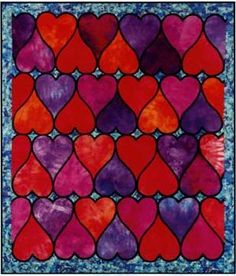 Stained Glass Hearts quilt pattern by Cindy Oravecz at Quilters Fancy. Only one shape is needed, and it is laid out right side up and upside down repetitively in rows so that the Clover Quick Bias is applied in one long, continuous piece, row by row.