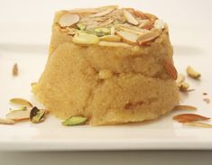 Sooji and besan cooked in ghee with sugar and enriched with almonds and pistachios.