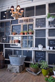 Re-Purposing old frames. Clever chalkboard surface. This would be helpful for a back side wall or shed to write reminders, to-do lists, and watering schedules for different plants. *love the little chandeleir on the patio too*