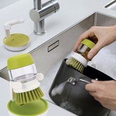Palm Scrub Dish Brush with Washing Up Liquid Soap Dispenser Storage Stand Kitchen Cleaning Tools Streamline your sink with this neat, compact design. This sturdy palm-held washing-up brush features an easy-fill washing-up liquid reservoir that dispenses Dish Washing Brush, Wash Brush, Washing Soap, Buy Kitchen, Kitchen Tools, Kitchen Cleaning, Kitchen Gadgets, Kitchen Appliances, Design Plat