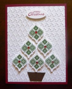 handmade Christmas card .. MOSAIC Christmas tree ... cute tree made up of stamped and punched tiles .. sentiment die cut oval as tree topper ... embossing folder background texture ... luv it! ... Stampin' Up!