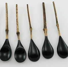 Mori Kowa is a master of Japanese Urushi, a very rare lacquer technique. Carved bamboo forms were laboriously hand dipped in thin coats of natural tree lacquer, polished, and dried between layers, to develop a lustrous matte black surface.