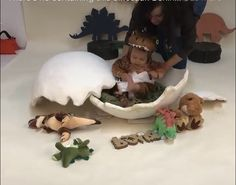 Baby photo shoot idea. Dinosaur hatching from the egg.